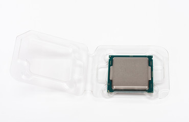 Processor in plastic packaging on white background