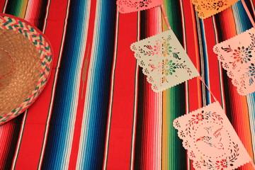 Mexico poncho sombrero serape background fiesta papel picado cinco de mayo decoration bunting stock, photo, photograph, picture, image