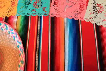 Mexican bunting poncho sombrero background fiesta cinco de mayo decoration papel de picado striped copy space pattern  stock, photo, photograph, image, picture