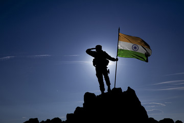 Soldier on top of the mountain with the Indian flag