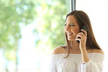 Girl calling on phone landline at home