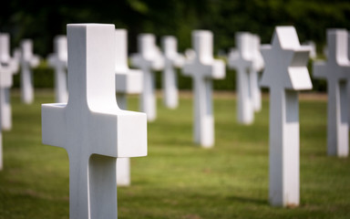 American Cemetery, Cambridge, UK. Focus on the foreground Crucifix headstone with Jewish Star of David behind.