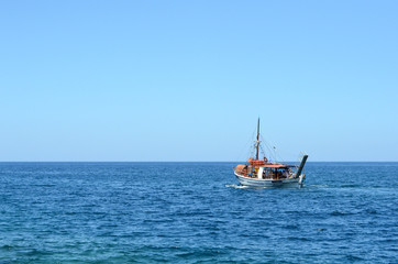 Boat in the sea on backgrounf od blue sky