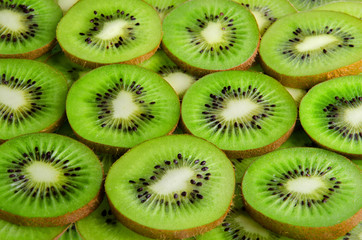 Background of green slices kiwi