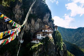 Bhutan Taktshang monastery Tigers Nest temple sight on a mountain with prayer flags