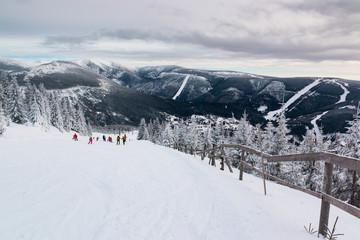 People on mountain in Czech ski resort Spindleruv Mlyn