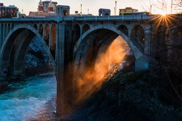 Sun shining through steam under the Monroe Street Bridge in Spokane Wall mural