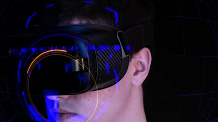 f52f219eb27 0 26 Close-up shot of a young man wearing VR Headset playing virtual  reality games.