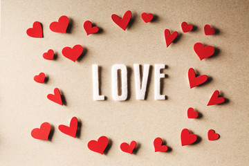 LOVE text with small red hearts