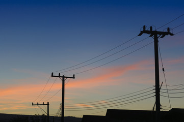 The silhouette  of electricity pole with the twilight scene