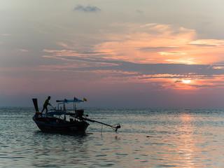 Longtail boat in the sunrise on Koh Lipe