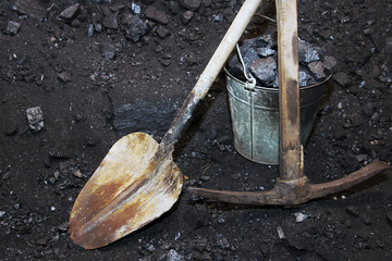 Coal mining. Shovel with a pickaxe and the bucket in mine