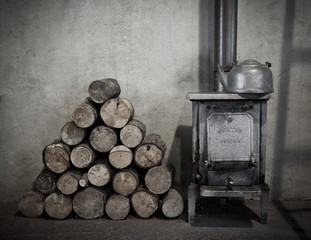 Old fire with wood stack