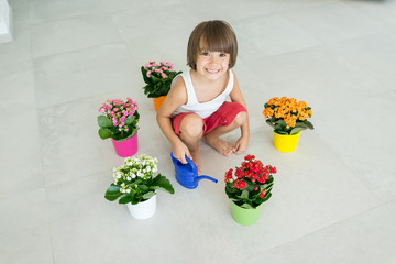 Kid taking care of plants and flowers at home