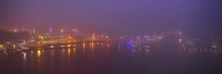 Amsterdam cityscape and beautiful mystic view from top at foggy night.