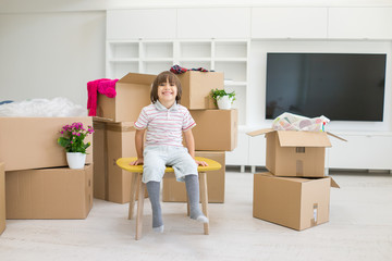 Happy kids with boxes at new modern home
