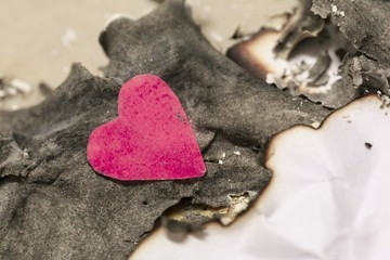Valentine's day abstract burning mark paper background with cut paper pink heart.