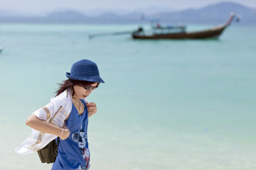 Young woman traveler relax and happy at Phuket beach, Thailand
