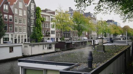 Smoke from houseboats along canals, Amsterdam, Netherlands