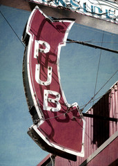 aged and worn vintage photo of neon pub sign