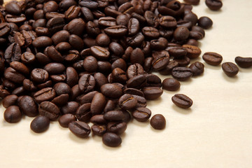 Coffee beans on the wood background.