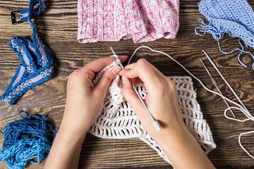 Knitting. Hand Crochet.  Female hand knit hook.