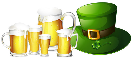 Fresh beer in glasses and green hat
