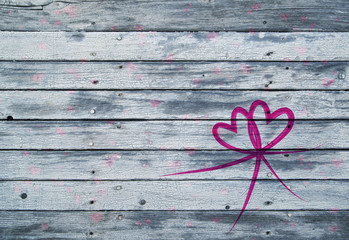 Illustrated pink red colored heart symbols on aged soft blue wooden texture planks with copy space background.