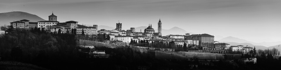Fotomurales - Bergamo Alta old town at sunset's lights - Lombardy Italy - black and white photo