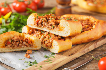 Turkish pide pizza with meat and cheese.