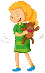 Girl holding teddy bear