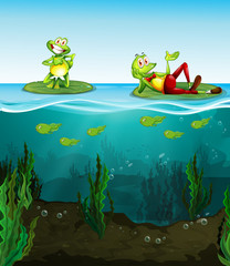 Two happy frogs and tadpoles in the pond