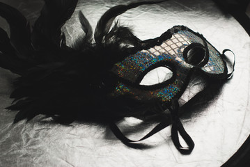 Black carnival mask with feathers,
