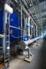 Large industrial water treatment and boiler room. Shiny pipes, p