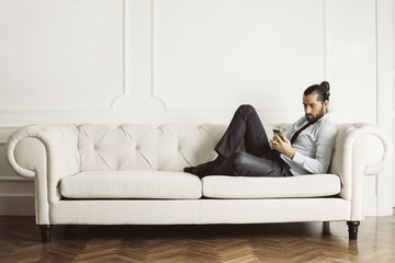 Man sitting of huge white sofa