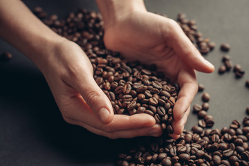 coffee beans in hand