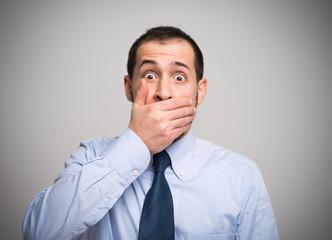 man shutting his mouth