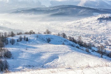 Winter at the Carpathian mountains, snowy alpine countryside landscape