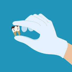Rotten tooth in the hand of the doctor in light blue gloves. Flat