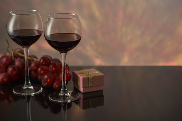Valentines Day with a glass of red wine, grapes, gift.