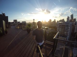 Man taking a selfie with Sydney Skyline on background, Australia