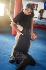 Kapap instructor demonstrates standing arm lock techniques