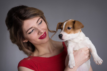 woman with a puppy Jack Russell