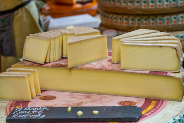 Wheel of Comte Cheese cut in Wedges