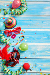 Streamers and party favors on wooden paneling