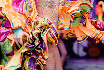 Foto auf AluDibond Karneval Brazilian Carnival. Dancing in bright tropical colors. Toning.Shallow depth of field.