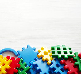 Colorful interlocking plastic pieces on white background