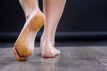 Close up of graceful womans foot.
