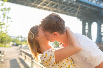 Young Couple in Love Visiting Brooklyn Bridge . New York City US