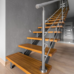 Simple staircase with steel railing